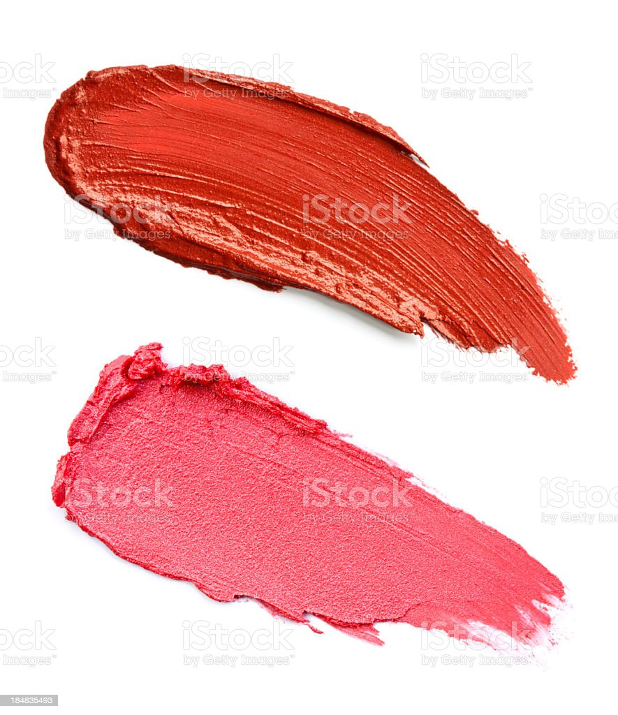 Two different red lipsticks smeared on a white background royalty-free stock photo