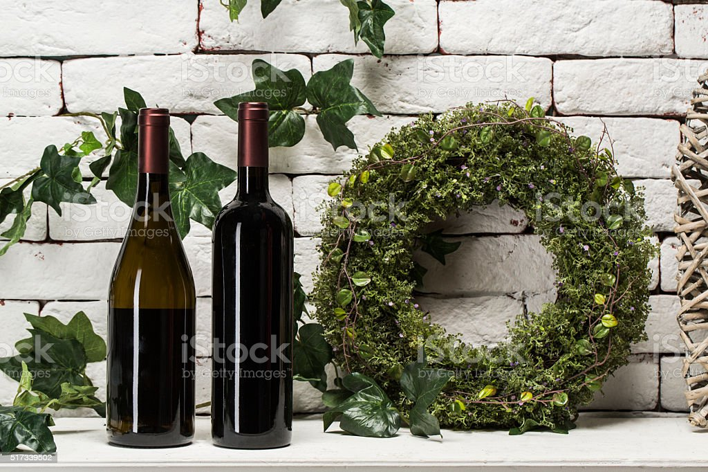 Two different red wine bottles isolated on white stock photo