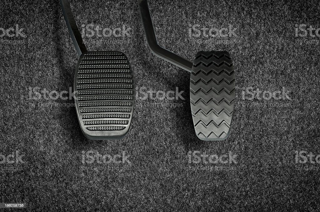 Two different textured pedals for a car stock photo