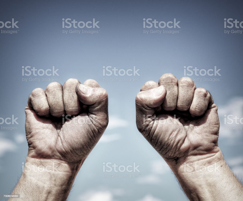 Two dirty male hands clenched in fist stock photo