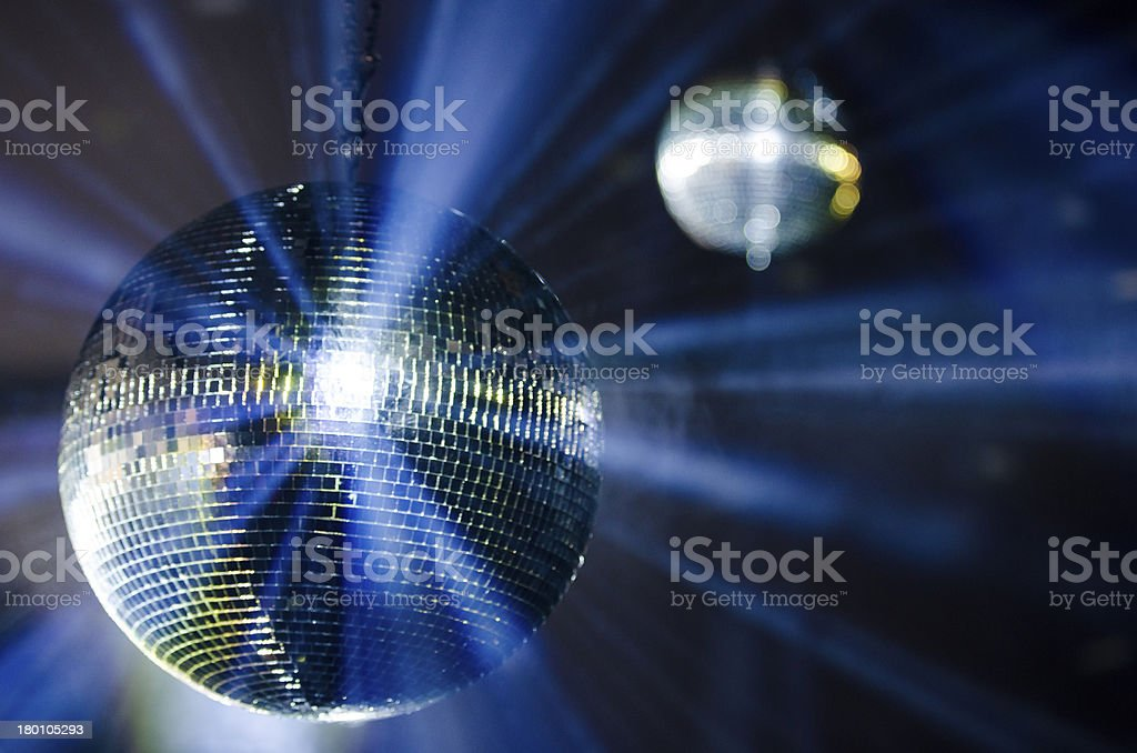 Two Disco Balls With Blue and Gold Light stock photo