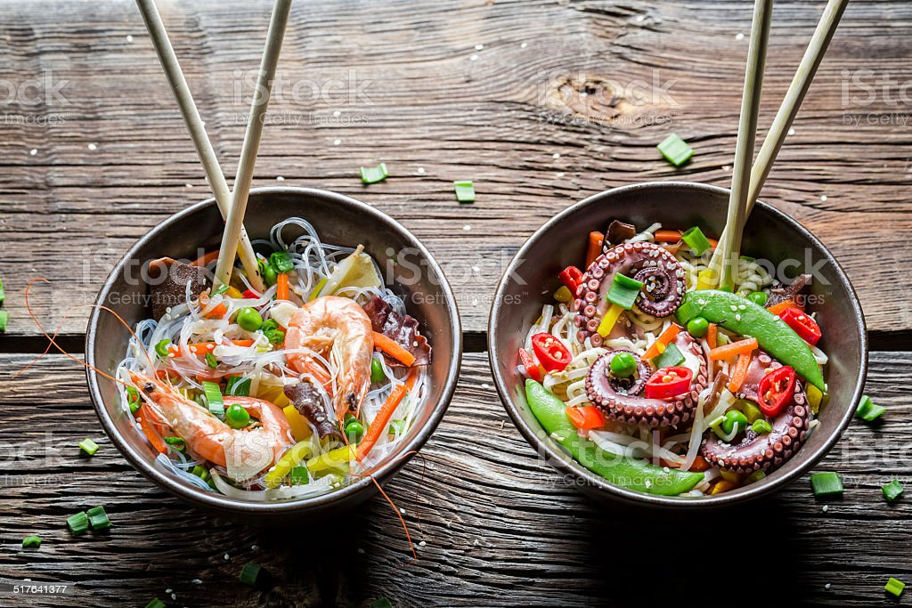 Two dishes with vegetables and seafood stock photo