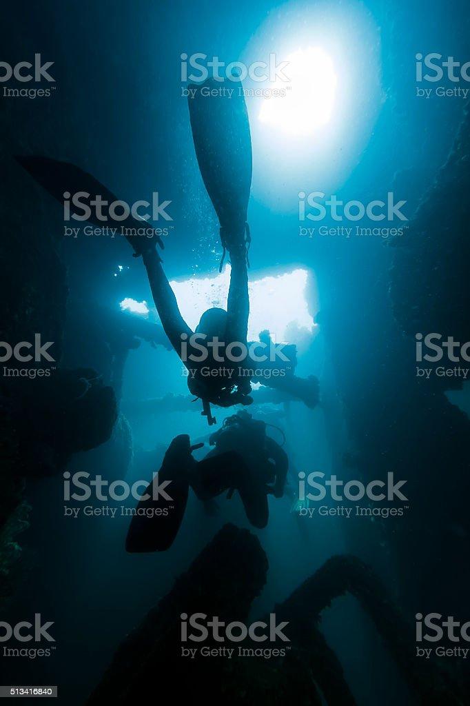 Two Divers Scuba Scubadiving Inside Sunken Ship stock photo