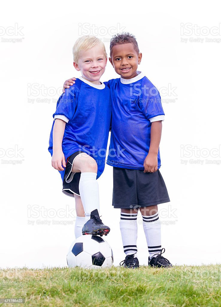 Two diverse young soccer players on white background stock photo