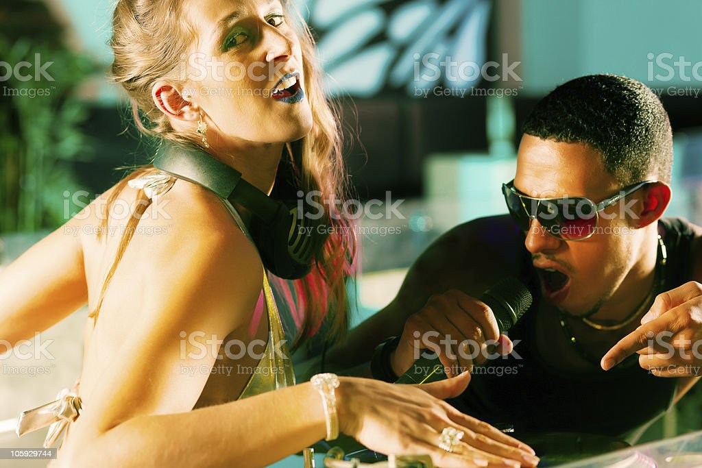 Two DJs at the turntable in club stock photo