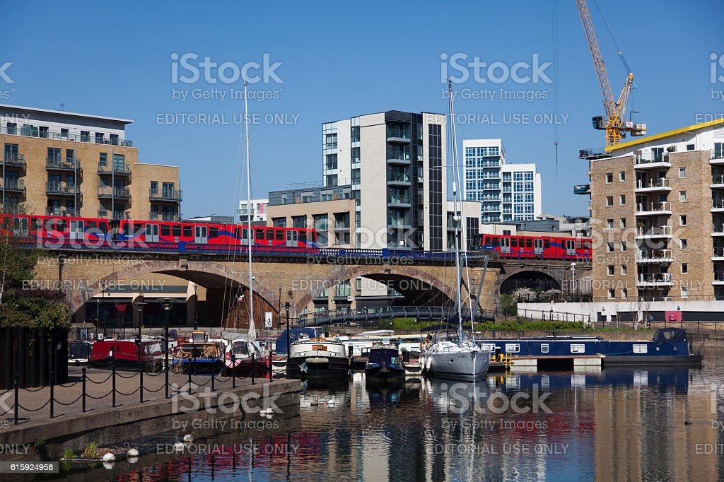 two DLR Trains passes over the viaduct stock photo