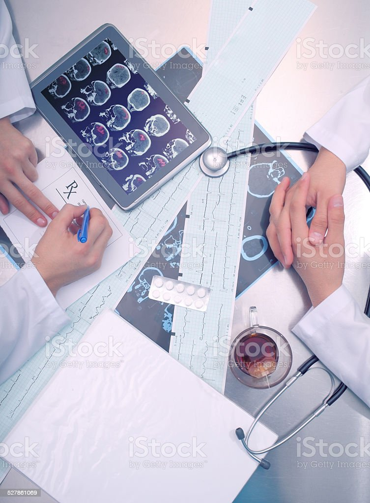 Two doctors at the table stock photo