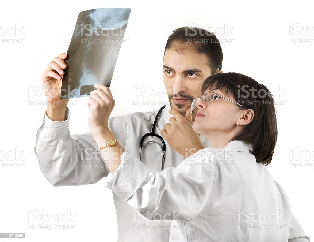 Two doctors checking an x-ray royalty-free stock photo