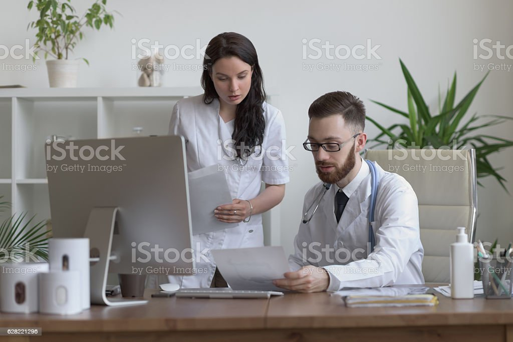 Two doctors discussing test results stock photo