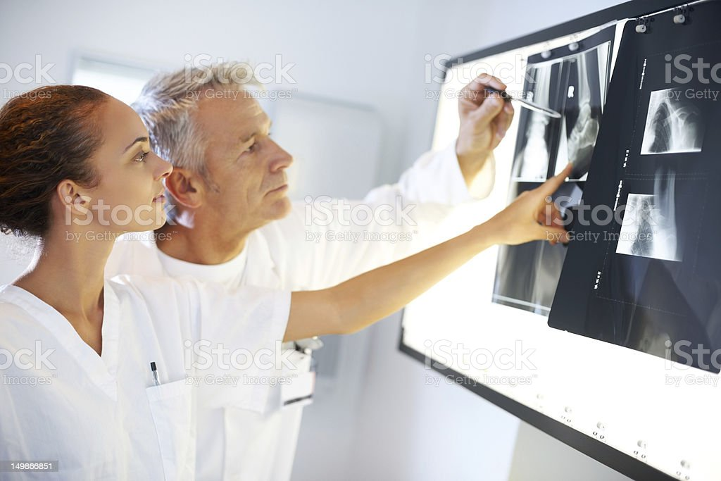 Two doctors discussing x-ray results stock photo