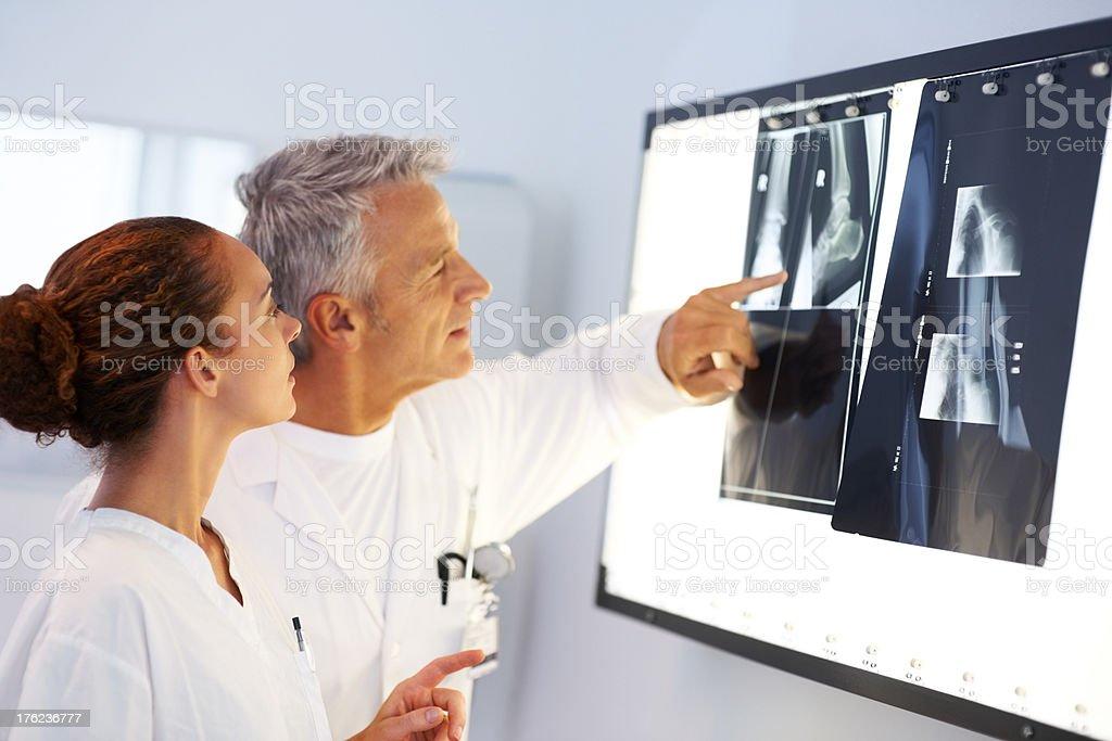 Two Doctors examining a x-ray at hospital stock photo
