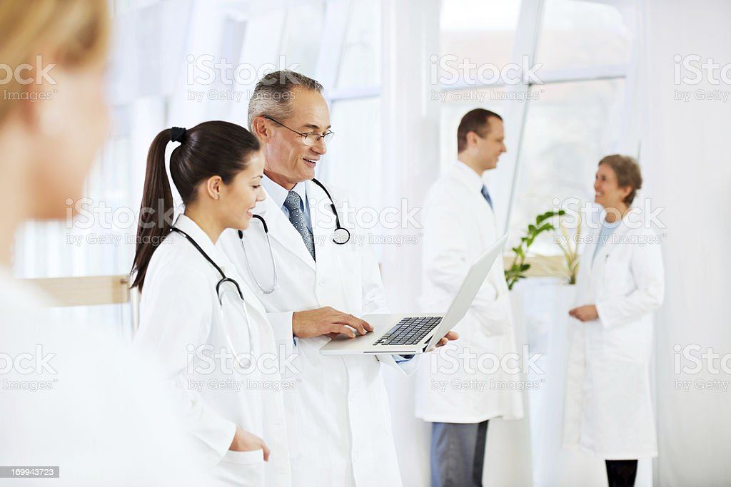 Two doctors looking at the laptop. royalty-free stock photo