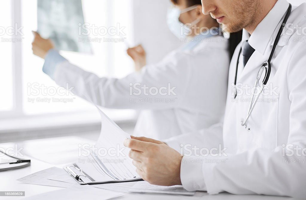 two doctors looking at x-ray royalty-free stock photo