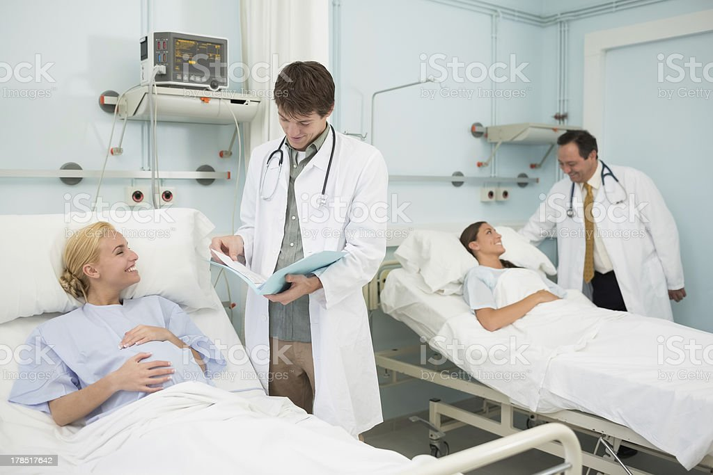 Two doctors talking to female patients royalty-free stock photo
