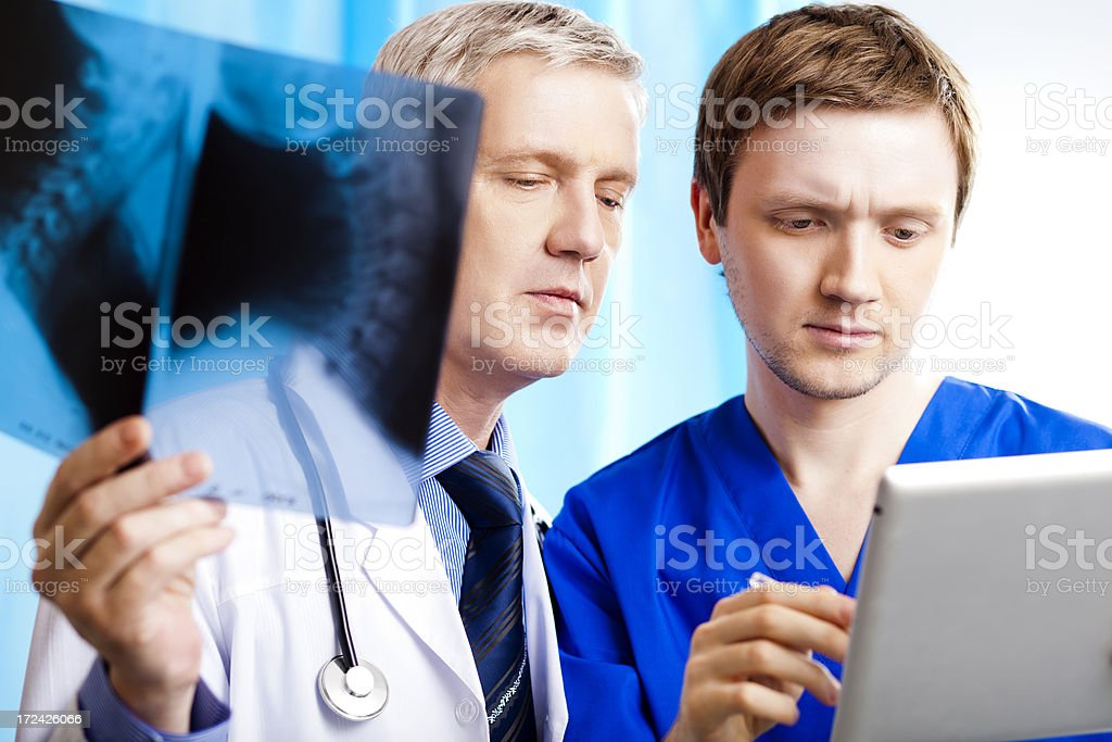 Two doctors using digital tablet royalty-free stock photo