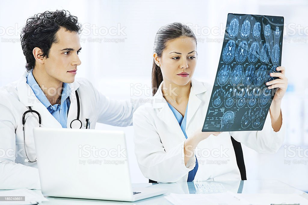 Two doctors with brain x-ray. royalty-free stock photo