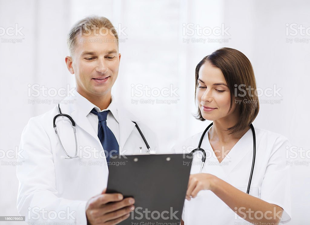 two doctors writing prescription royalty-free stock photo