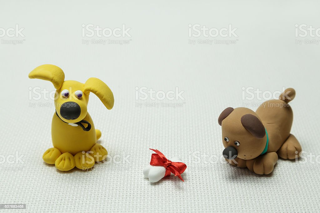 Two dogs and a bone tied up by a band stock photo