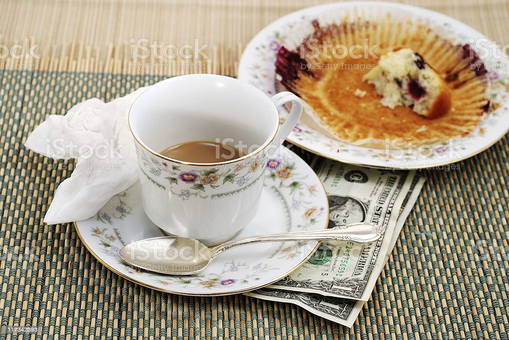 Two dollar tip after breakfast royalty-free stock photo