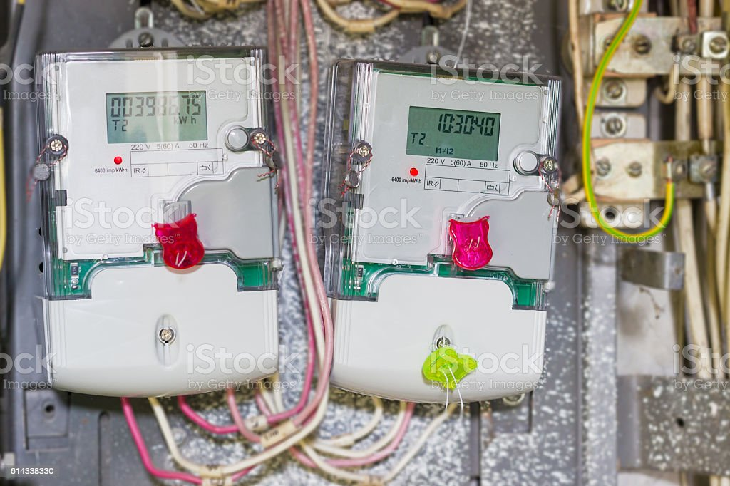 Two domestic digital electricity meter, mounted in distribution stock photo