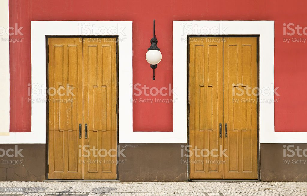 Two doors against color wall royalty-free stock photo