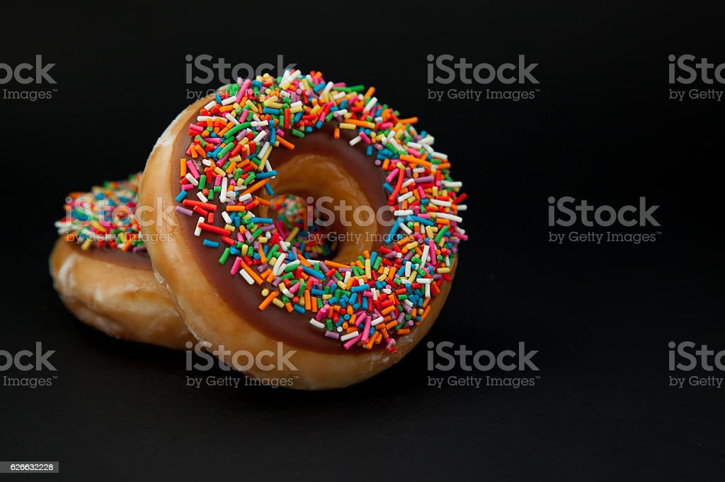 two doughnuts on a black background royalty-free stock photo