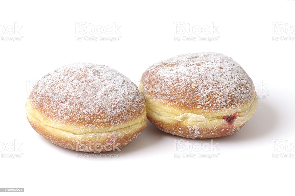 two doughnuts with jam and icing sugar, isolated on white stock photo