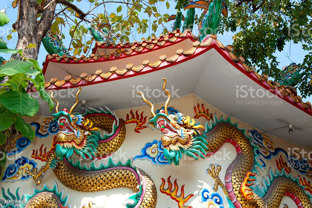 Two Dragon on gates of the temple in Bangkok, Thailand stock photo