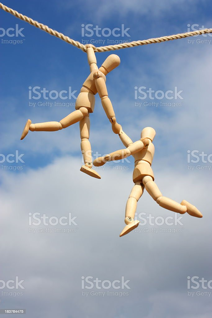 Two drawing mannequins hanging from rope royalty-free stock photo