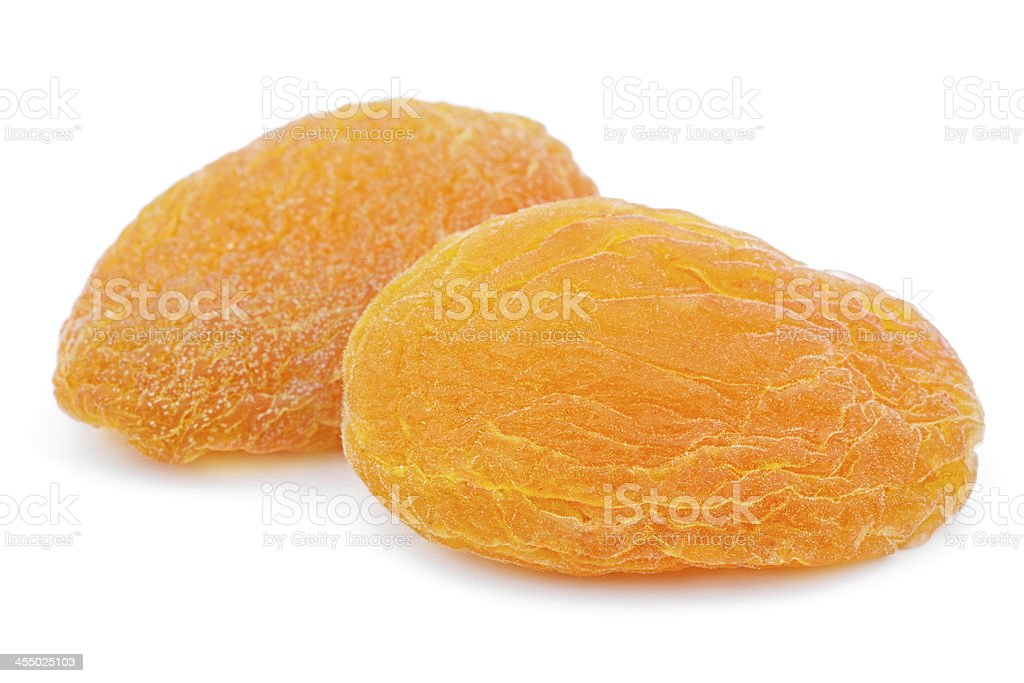 Two dried apricot fruits on white stock photo