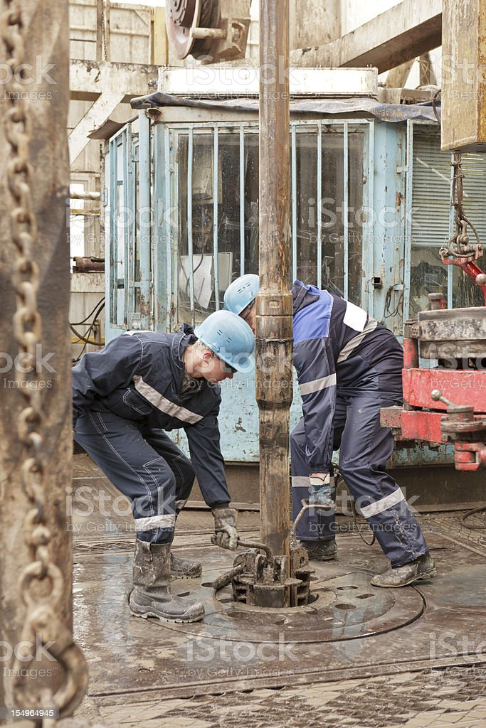 Two drillers at work stock photo