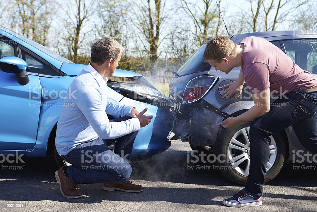 Two Drivers Arguing After Traffic Accident royalty-free stock photo