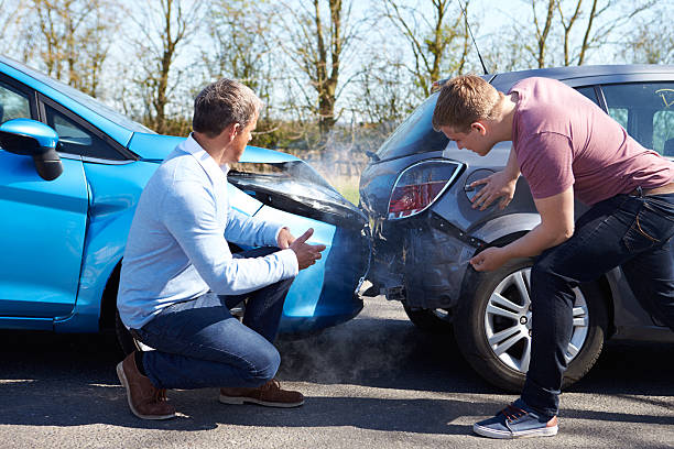 two drivers arguing after traffic accident stock photo