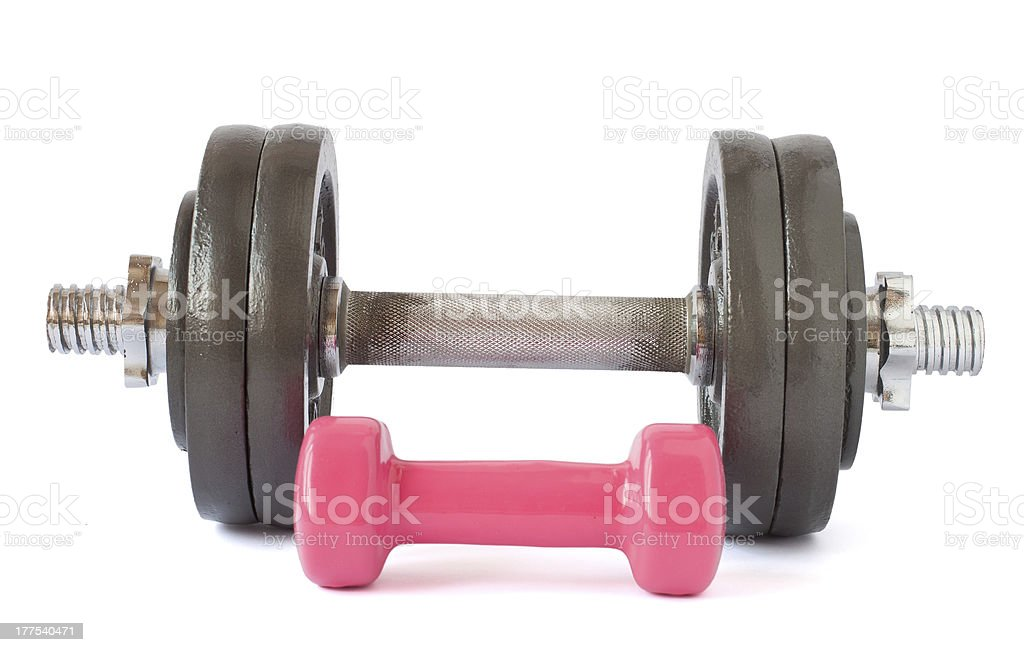 Two dumbbells close-up on a white background. royalty-free stock photo