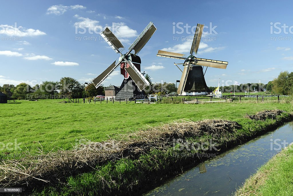 Two Dutch windmills royalty-free stock photo
