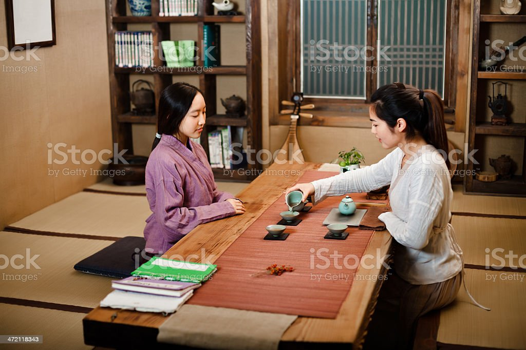 Two east asian girl showing Tea Ceremony royalty-free stock photo