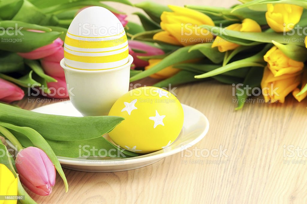 Two easter Egg with bunch of Tulips stock photo