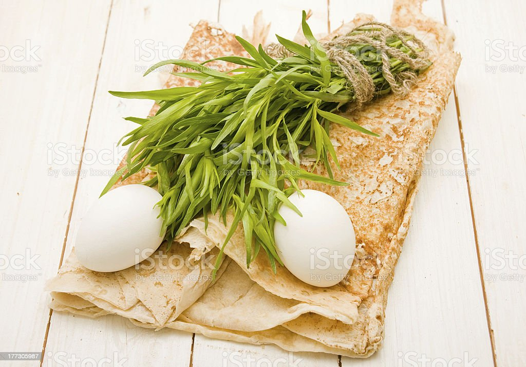 Two eggs and bunch of tarragon on pita royalty-free stock photo