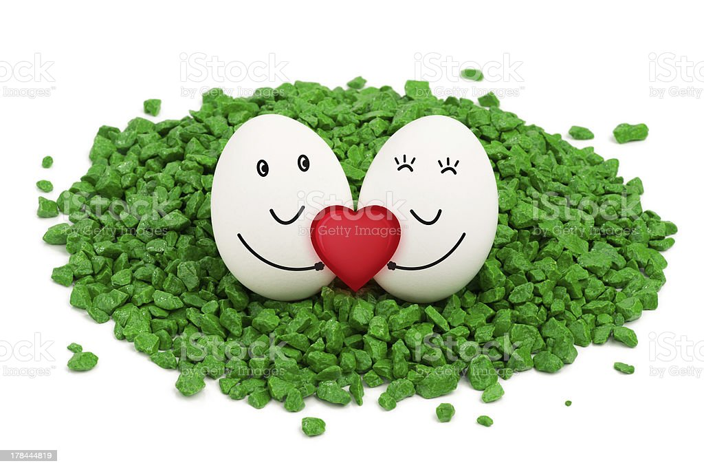 Two eggs on green stones. royalty-free stock photo