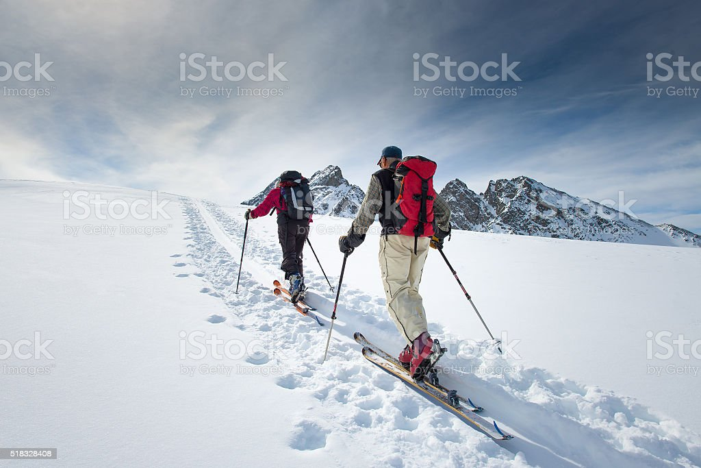 Two elderly alpine skiers stock photo
