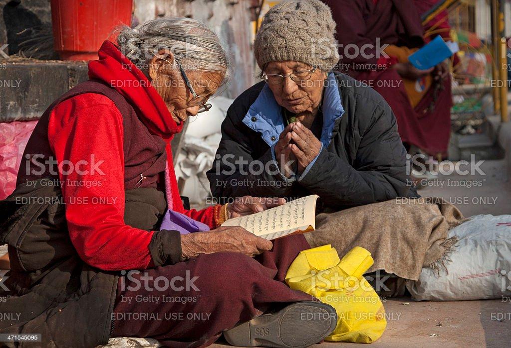 Two elderly women praying royalty-free stock photo