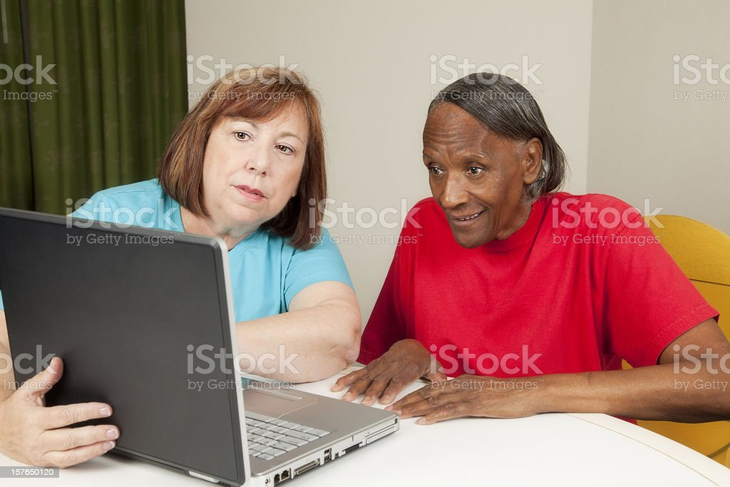 Two elderly women working on a laptop royalty-free stock photo