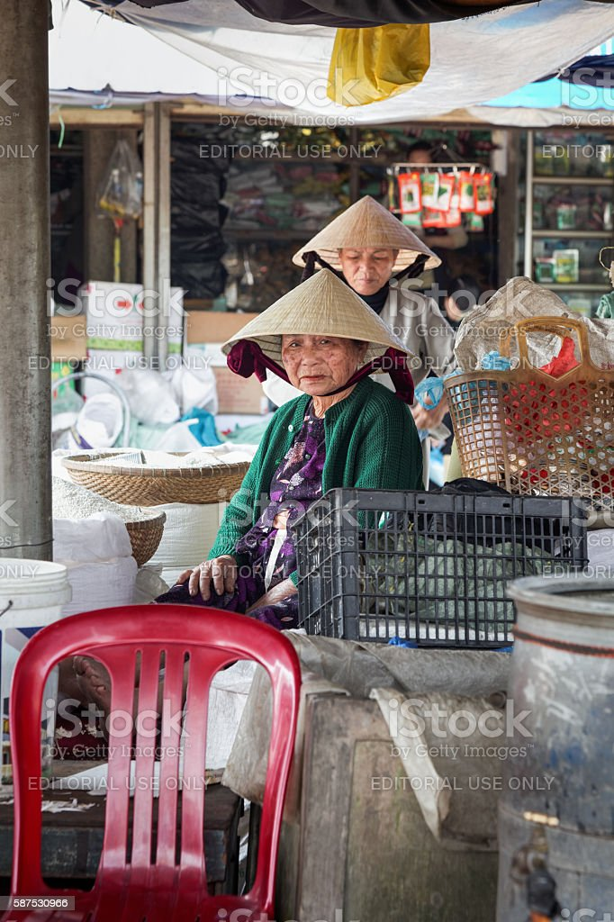 Two eldery women taking a rest in the marke stock photo