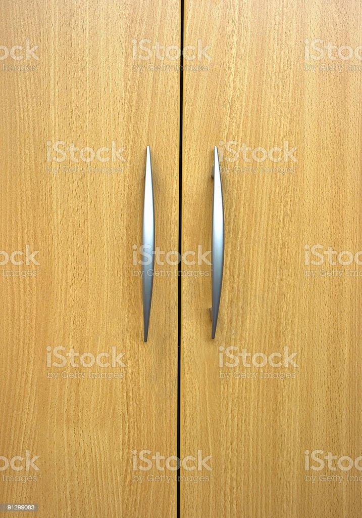 Two elegant cabinet handles stock photo