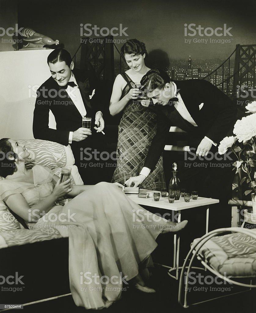 Two elegant couples on party, (B&W) stock photo