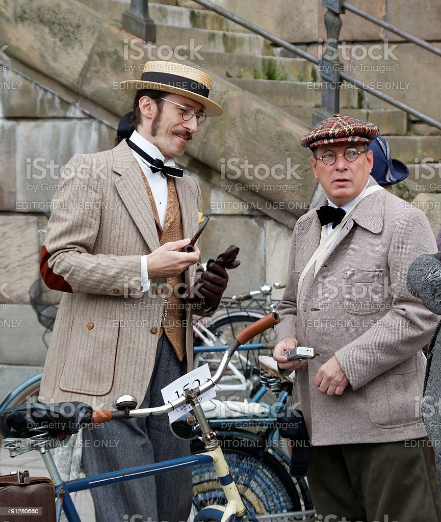Two elegant men wearing old fashioned clothes stock photo