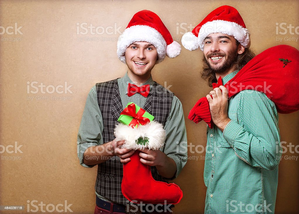 Two emotional Santa Claus dressed in clothes hipster with royalty-free stock photo