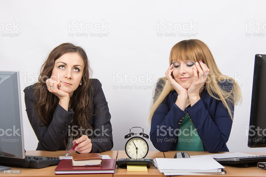 Two employee in the office waiting for the end stock photo