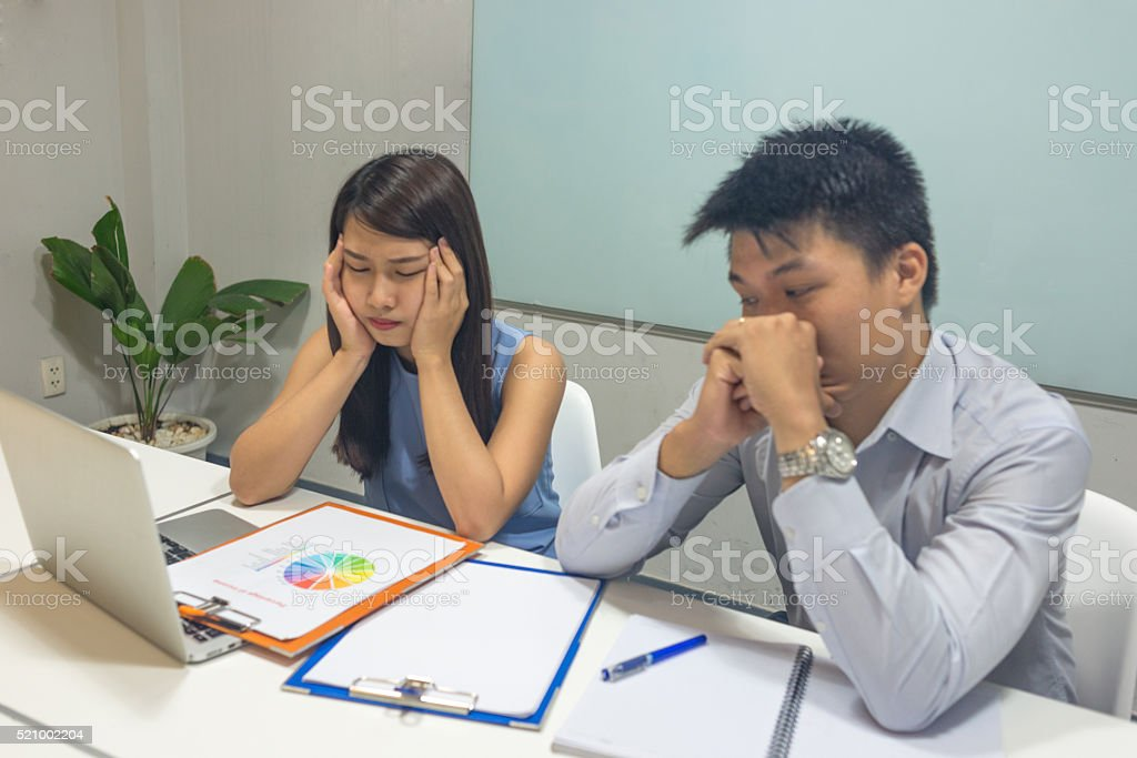 Two employees stucked with the big issue at work stock photo
