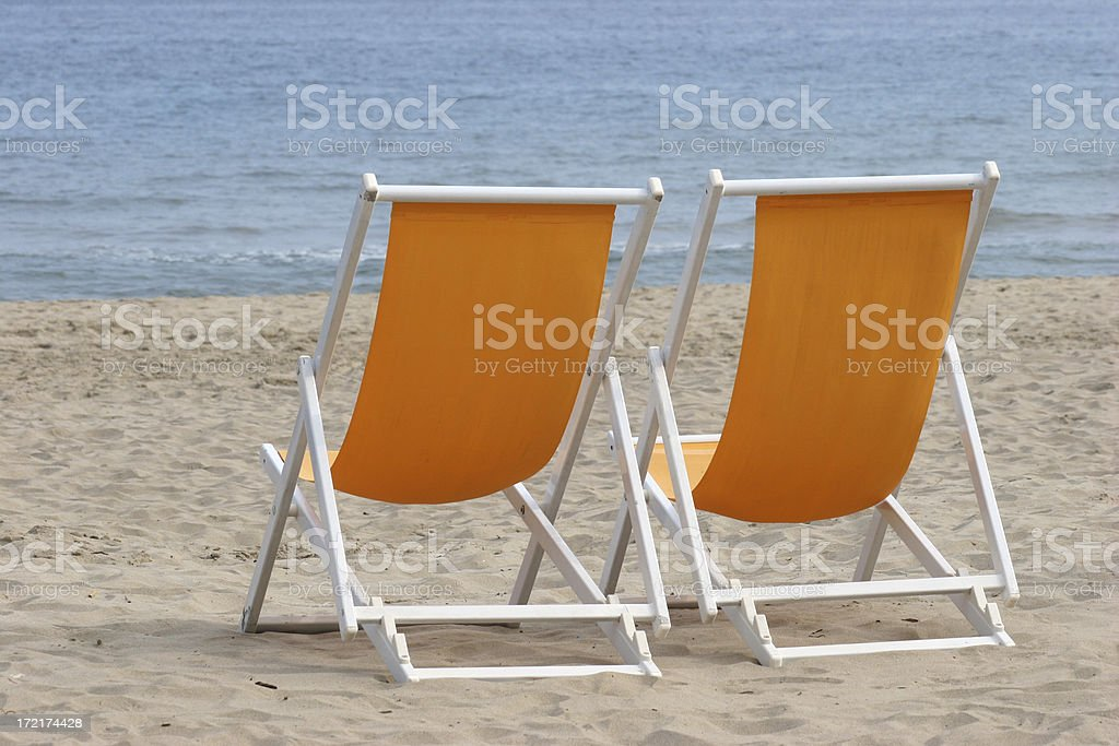 two empty beach deckchairs royalty-free stock photo